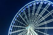 GDANSK, POLAND - 8 AUGUST 2014: Ferris wheel in the city centre of Gdansk at night. Gdansk is the historical capital of Polish Pomerania with medieval old town architecture.