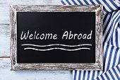 Welcome abroad written on chalkboard, close-up
