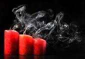 three red extinguished candles