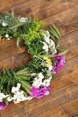 Wildflower wreath on wooden background