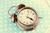 Clock on blue polka dot pillow, close-up