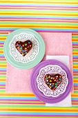 Delicious rainbow mini cakes on paper napkin, on bright background