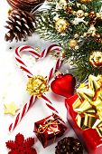 Christmas Candy Canes and decorations over white