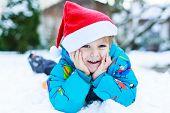 Happy Little Toddler Boy Waiting For Christmas Santa Hat