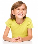 Portrait of a happy little girl laughing, isolated over white