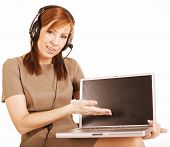 mature woman with headset and notebook