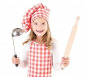 image of ladle  - Smiling cute little girl in chef hat with ladle and rolling pin isolated on a white - JPG