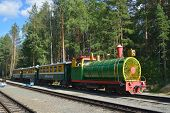 NOVOSIBIRSK, RUSSIA - AUGUST 20, 2014: Train on the station Sportivnaya of Children's railway. Built