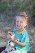 Screaming Little Girl With Kitten
