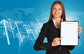 Businesswoman with graphs, arrows and world map