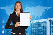Businesswoman with world map, graphs and building