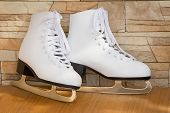 The Female Skates And Boots Of White Color For Figure Skating.