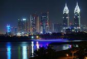 DUBAI, UAE - 2 February 2014: The Al Kazim Towers in Dubai Media. City at night.