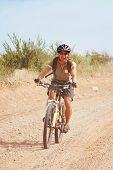 a girl riding a mountain bike in the hills