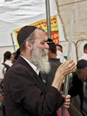 JERUSALEM, ISRAEL - SEPTEMBER 18, 2013: The gray-bearded religious Jew in a black skullcap carefully