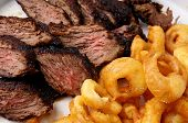 Flank Steak With Fries Onion Rings