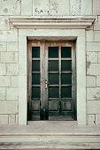 grunge image of an italian door.