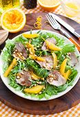 stock photo of duck breast  - Salad with roasted duck breast and orange - JPG