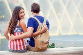 Happy couple in Las Vegas enjoying fountain. Romantic young couple on USA travel,