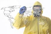 stock photo of modification  - A man wearing full biological suite drawing the map of the world