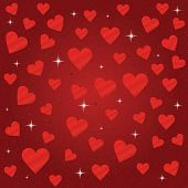 Shiny and silky red hearts and sparkles background