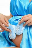 pic of faber  - Pregnant belly with blue booties and beautiful clother