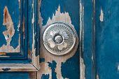 stock photo of door  - Silver metal door knob on an old wooden door - JPG