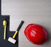 Texture Laminate And Tools With A Red Helmet