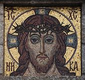 ROTAVA, CZECH REPUBLIC - MARCH 3, 2014: Jesus Christ mosaic on an abandoned mausoleum in Rotava, Western Bohemia, Czech Republic.