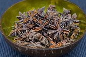 Star anise in a coconut bowl