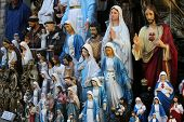 MARIJA BISTRICA, CROATIA - OCTOBER 26, 2013: Catholic Religious items, figurines of saints in one of the Souvenir shops in  pilgrimage Sanctuary Assumption of the Virgin Mary