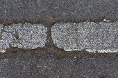 Close Up A Crack Line On The Road