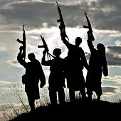 image of rifle  - Silhouette of several muslim militants with rifles - JPG