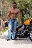 stock photo of biker  - Biker Man Body builder And The Bike - JPG