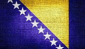 Bosnia and Herzegovina flag on burlap fabric
