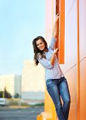Summer, Fashion And People Concept - Pretty Smiling Woman In Casual Clothes Outdoors Having Fun Agai