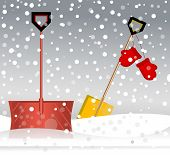 Shovels resting in the snow - taking a break in a storm