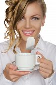 Woman With Tea Bag In Your Mouth And Cup