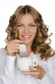 Woman With Tea Bag And Cup In Hand