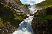 Giant Kjosfossen waterfall in Flam - Norway - nature and travel background