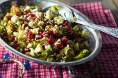 stock photo of brussels sprouts  - Balsamic walnuts pomegranite and brussel sprout salad - JPG