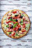 Cheese pizza with cherry tomatoes, red onion and capers