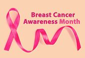 Pink breast cancer ribbon on beige background, Breast Cancer Awareness Month Concept