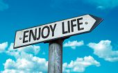 Enjoy Life sign with sky background