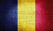 stock photo of chad  - Grunge of Chad flag on burlap fabric - JPG