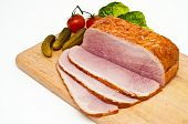Ham Joint On A Wooden Cutting Borad