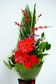 stock photo of gerbera daisy  - Bouquet with Daisy flower red gerbera and green leaves - JPG