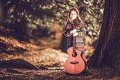 pic of guitar  - Girl and Guitar in the Park - JPG