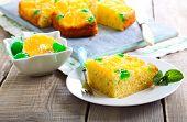 stock photo of clementine-orange  - Cherry dots orange upside down cake on plate  - JPG