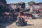 Woman Meditating In Ancient Ruins